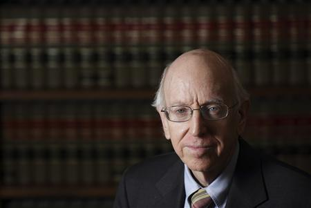 Federal Judge Richard Posner poses in his Chambers in Chicago July 2, 2012. The U.S. judge who tossed out one of the biggest court cases in Apple Inc's smartphone technology battle thinks policymakers should examine whether patents should cover software at all. Picture taken July 2, 2012. REUTERS/John Gress