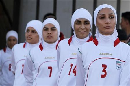 The Iranian women's national soccer team walk to the pitch before withdrawing from their qualifying match against Jordan for the 2012 London Olympic Games in Amman June 3, 2011. REUTERS/Ali Jarekji/Files