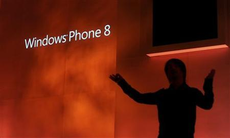 Joe Belfiore, corporate vice president of Microsoft, introduces the Windows Phone 8 mobile operating system in San Francisco, California, June 20, 2012. REUTERS/Noah Berger