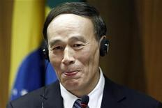 Wang Qishan, Deputy Prime Minister of China attends a news conference after meeting with the Brazil's Vice President Michel Temer at the Itamaraty Palace in Brasilia February 13, 2012. REUTERS/Ueslei Marcelino