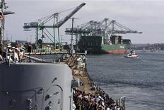 The battleship USS Iowa approaches the Ital Contessa cargo ship as it is moved to its final berth in the Port of Los Angeles, where it will become a floating museum, in the San Pedro section of Los Angeles, California, June 9, 2012. REUTERS/David McNew