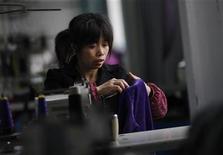 An employee works at the Yiwu Lianfa clothing factory in Yiwu, Zhejiang province, November 30, 2011. REUTERS/Carlos Barria