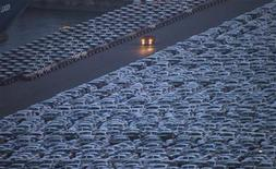 A truck is driven down a road at a yard where cars are parked before being exported at a port in Incheon, west of Seoul June 17, 2012. REUTERS/Choi Dae-woong