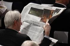 A participant reads about the soccer riot and clashes in Egypt in a newspaper during the 48th Conference on Security Policy in Munich February 5, 2012. REUTERS/Michaela Rehle
