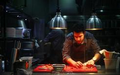 A chef works at the kitchen of Ultraviolet restaurant in Shanghai June 23, 2012. REUTERS/Carlos Barria