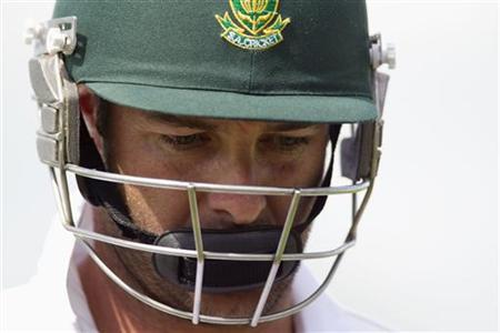 South Africa's Mark Boucher looks down as he leaves the ground after being bowled out by New Zealand's Mark Gillespie on day two of the second international cricket test match in Hamilton in this March 16, 2012 file photo. REUTERS/Nigel Marple/Files