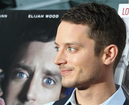 Elijah Wood, star of 'Wilfred' arrives at the FX Network series premiere of 'Wilfred' and season two launch of 'Louie' in Hollywood, California June 20, 2011. REUTERS/Fred Prouser