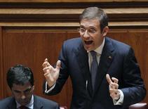 <p>Le Portugal doit continuer de servir d'exemple en Europe en matière d'ajustement budgétaire, a déclaré son Premier ministre, Pedro Passos Coelho, mercredi lors de son discours sur l'état de la Nation. /Photo prise le 11 juillet 2012/REUTERS/Hugo Correia</p>