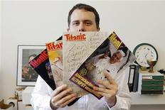 """Leo Fischer, editor-in-chief of the German magazine """"Titanic"""", poses for a picture in his office in Frankfurt July 11, 2012. REUTERS/Alex Domanski"""