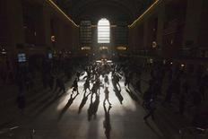 Morning commuters are silhouetted as they walk through the main concourse of the Grand Central Terminal, also known as Grand Central Station, in New York March 5, 2012. REUTERS/Adrees Latif