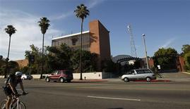 A cyclist passes the building where television station KCET used to be housed in Los Angeles, California July 10, 2012. REUTERS/Mario Anzuoni