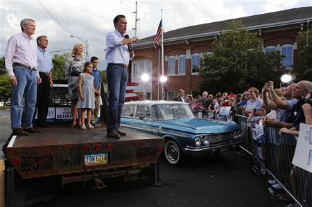 U.S. Republican presidential candidate Mitt Romney speaks outside K's Hamburger Shop while standing on a flatbed truck parked next to a 1961 Rambler classic car in Troy, Ohio, June 17, 2012. Romney had been on a campaign bus tour since Friday for a five-day road trip through six battleground states. Joining him are (L-R): Senator Rob Portman (R-OH), Speaker of the House John Boehner and Romney's wife, Ann. REUTERS/Larry Downing