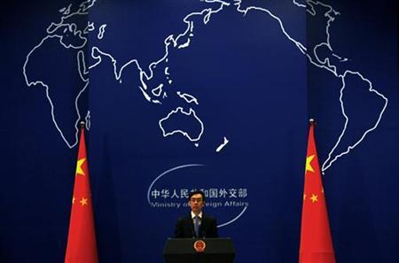 China's Foreign Ministry spokesman Liu Weimin listens to a question during a news conference in Beijing in this November 21, 2011 file photo. REUTERS/David Gray/Files