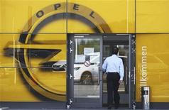 An employee of German car manufacturer Opel enters a building at the headquarters of Opel in Ruesselsheim, 20km from Frankfurt May 14, 2012. REUTERS/Alex Domanski