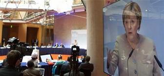 Germany's Chancellor Angela Merkel speaks at the Petersberg Climate Dialogue (Petersberger Klimadialog) in Berlin July 16, 2012. REUTERS/Thomas Peter