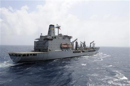 The U.S. Navy supply ship USNS Rappahannock maintains station as it prepares a replenishment at sea in this U.S. Navy photo handout photo taken in the South China Sea March 21, 2012. A security team aboard the Rappahannock fired upon a small motor boat off the United Arab Emirates July 16, 2012 after it ignored warnings to halt its approach, officials said. REUTERS/MC3 Cale Hatch/US Navy/Handout