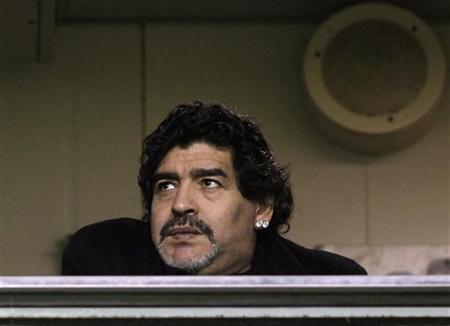 Argentine soccer legend Diego Maradona, coach of UAE's Al Wasl, waits for the start of the Argentine First Division soccer match between Boca Juniors and Arsenal in Buenos Aires June 17, 2012. REUTERS/Marcos Brindicci
