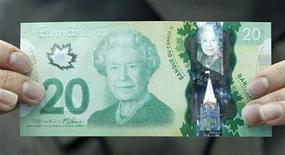 The new Canadian 20 dollar bill made of polymer is displayed at the Bank of Canada in Ottawa May 2, 2012. REUTERS/Chris Wattie