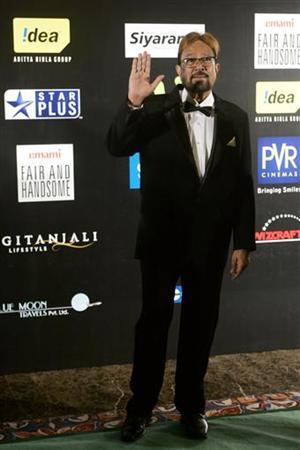 Bollywood actor Rajesh Khanna arrives to attend the Fashion Extravaganza during the 10th International Indian Film Academy (IIFA) weekend in Macau June 12, 2009. REUTERS/Tyrone Siu/Files
