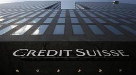A logo is seen in front of a Credit Suisse building in Zurich, May 4, 2012. REUTERS/Christian Hartmann