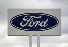 The logo of Ford car manufacturer is seen on a giant board at the Ford car plant in Saarlouis, August 26, 2010. REUTERS/Vincent Kessler