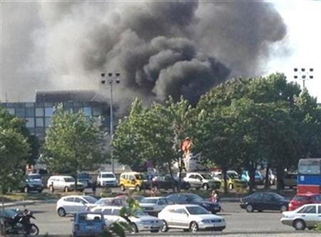 Smoke is seen after a blast at Bulgaria's Burgas airport July 18, 2012. REUTERS/Stringer