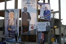 Election campaign posters of independent candidates running for Libya's National Congress are seen on a street in Tripoli June 27, 2012. REUTERS/Anis Mili