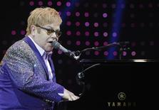 """British singer Elton John performs during a concert as part of his """"Greatest hits Live 2012"""" world tour at the Ondrej Nepela Arena in Bratislava July 10, 2012. REUTERS/Radovan Stoklasa"""
