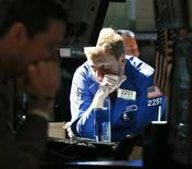 Traders work on the floor of the New York Stock Exchange, July 2, 2012. REUTERS/Brendan McDermid