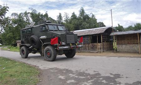 An Indian army bullet-proof vehicle patrols through a street during curfew near Kokorajhar town in the northeastern Indian state of Assam July 22, 2012. REUTERS-Stringer