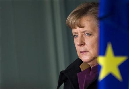 German Chancellor Angela Merkel stands next to an European flag as she waits for the arrival of Bulgarian Prime Minister Boyko Borissov (not pictured) at the Chancellery in Berlin, January 18, 2012. REUTERS/Thomas Peter