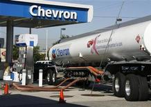 A Chevron tanker truck unloads gasoline into underground storage tanks in Burbank, Calfiornia June 18, 2008. REUTERS/Fred Prouser
