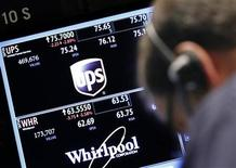 A trader works at the post that trades UPS and Whirlpool on the floor of the New York Stock Exchange, July 24, 2012. REUTERS/Brendan McDermid