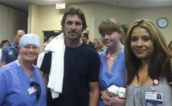 Actor Christine Bale (C), poses with hospital staff at the Swedish Medical Center in Denver July 24, 2012 in this handout photo supplied courtesy of Swedish Medical Center. REUTERS/Swedish Medical Center/Handout
