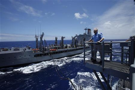 U.S. Secretary of the Navy Ray Mabus watches as the USNS Kaiser (L) re-fuels the USS Princeton with biofuel about 150 miles north of the island of Oahu during the RIMPAC Naval exercises off Hawaii July 18,2012. REUTERS/Hugh Gentry
