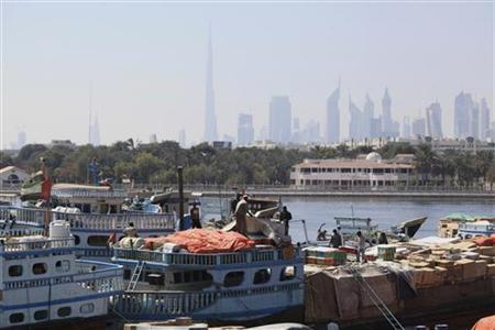 Ships are seen as goods are unloaded at the port in Deira, February 27, 2012. REUTERS/Ashraf Abu Omar