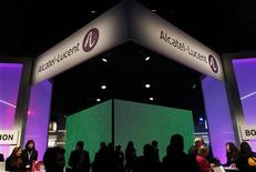 Visitors walk at the Alcatel-Lucent booth at the Mobile World Congress in Barcelona February 28, 2012. REUTERS/Albert Gea