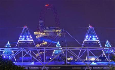 A light display is seen at the Olympic Stadium after a full dress rehearsal in London late July 25, 2012. REUTERS/ Ki Price