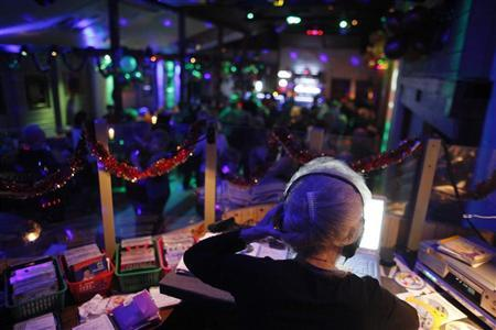 A DJ plays music at a club in Warsaw January 4, 2012. REUTERS/Kacper Pempel