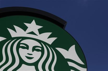 Starbucks logo is seen outside the new Starbucks cafe in Warsaw March 6, 2011. REUTERS/Kacper Pempel
