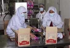 Afghan women work at an ice cream factory in Herat province July 22, 2012. REUTERS/Amie Ferris Rotman