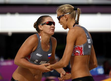 Russia's Anastasia Vasina (R) and Anna Vozakova celebrate a point against China's Zhang Xi and Xue Chen during the women's beach volleyball preliminary match at the Horse Guards Parade during the London 2012 Olympic Games July 28, 2012. REUTERS/Marcelo Del Pozo