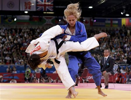 Germany's Romy Tarangul fights with Italy's Rosalba Forciniti (blue) during their women's -52kg elimination round of 16 judo match at the London 2012 Olympic Games July 29, 2012. REUTERS/Toru Hanai