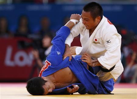Japan's Masashi Ebinuma wins in men's judo 66kg ...