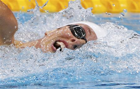 France's Camille Muffat swims during the women's 400m freestyle heats at the London 2012 Olympic Games at the Aquatics Centre July 29, 2012. REUTERS/David Gray