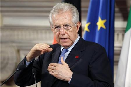 Italian Prime Minister Mario Monti gestures next to German Chancellor Angela Merkel during a news conference at Villa Madama in Rome July 4, 2012. REUTERS/Max Rossi
