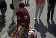 """A supporter of female punk band """"Pussy Riot"""" waits outside the court where three members of the band are on trial in Moscow July 30, 2012. REUTERS/Maxim Shemetov"""