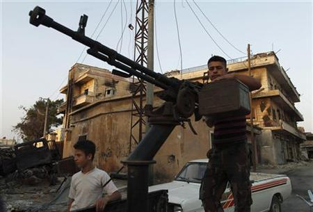 A Free Syrian Army member stands by his anti-aircraft machine gun during their patrol in Attarib, on the outskirts of Aleppo province July 30, 2012. REUTERS/Zohra Bensemra