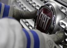 <p>Fiat annonce un bénéfice opérationnel au deuxième trimestre d'un milliard d'euros, à la faveur de ventes soutenues aux Etats-Unis de sa filiale Chrysler et de pertes réduites en Europe. /Photo d'archives/REUTERS/Ivan Milutinovic</p>