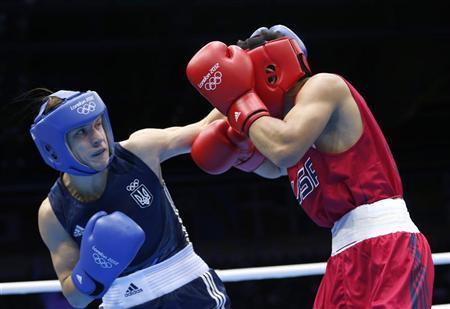 Ukraine's Pavlo Ishchenko (L) fights against Joseph Diaz Jr. of the U.S. (R) in the Men's Bantam (56kg) Round of 32 Bout 1 boxing match at ExCeL venue during the London 2012 Olympic Games July 28, 2012. REUTERS/Murad Sezer